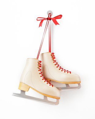 vintage skates hanging on the white wall